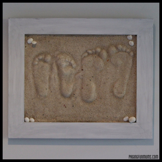 framed foot prints in sand, showing a DIY gift for grandparents from grandkids