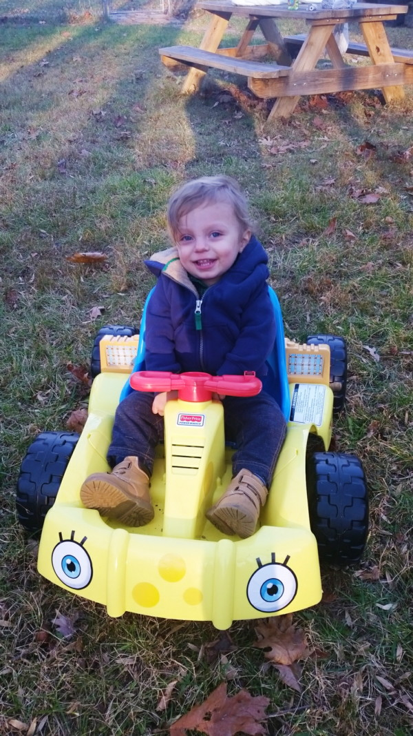 18 month old in a spongebob powerwheels