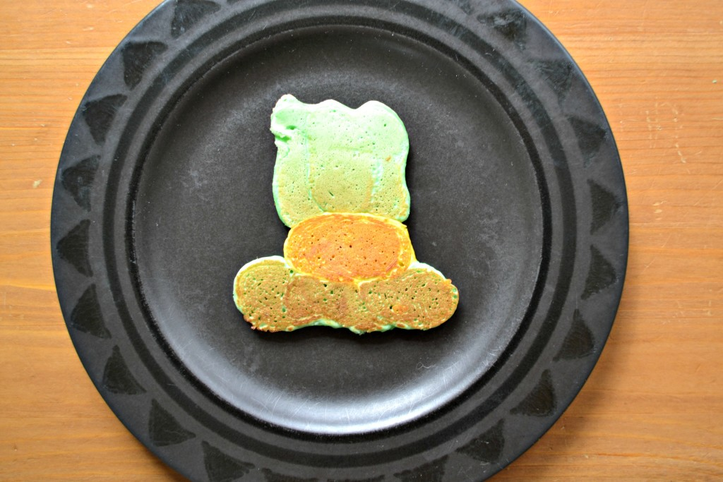 St. Patrick's Day pancakes are fun for everyone! Check out this post to learn how to make simple and festive pancakes, like these fun leprechaun hat pancakes!