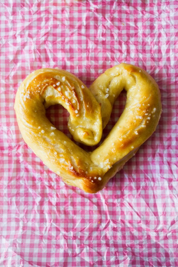 heart shaped Soft Pretzels on a pink gingham tissue paper background