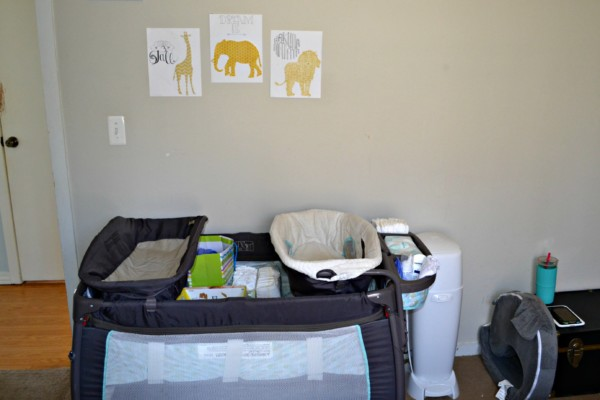 a picture of a small bedroom nursery with a pack and play