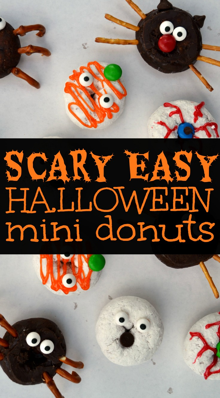 a pinable image with an overhead shot of various mini halloween donuts ith text overlay reading scary easy halloween donuts