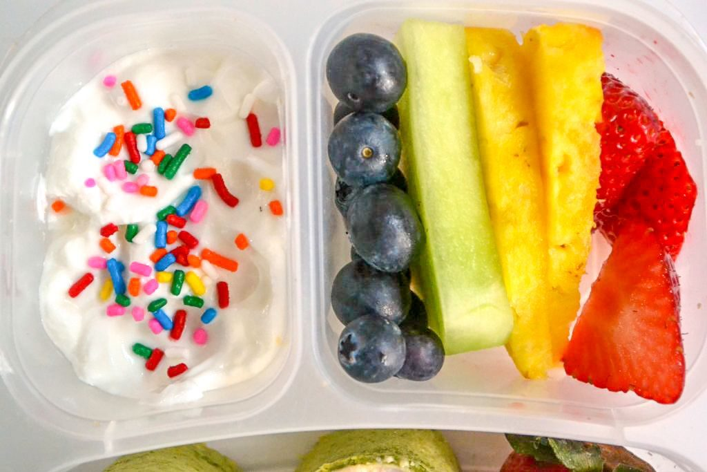 sides for a rainbow lunch box with rainbow fruit and yogurt topped with rainbow sprinkles