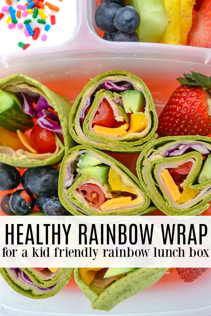 his rainbow lunch box is a fun twist on a traditional school lunch - and an easy way to encourage kids to try new veggies. With a rainbow wrap full of colorful vegetables and flavorful hummus, kids can't resist taking a bite - and then another and another until the entire lunchbox is devoured!  #eattherainbow #backtoschool #lunchbox #healthylunch #kidslunch #healthykidslunch