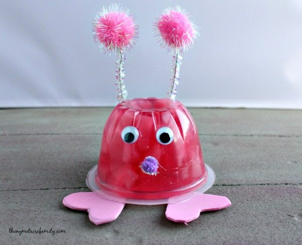 "a pink fruit cup with accessories to look like a ""lovebug"""