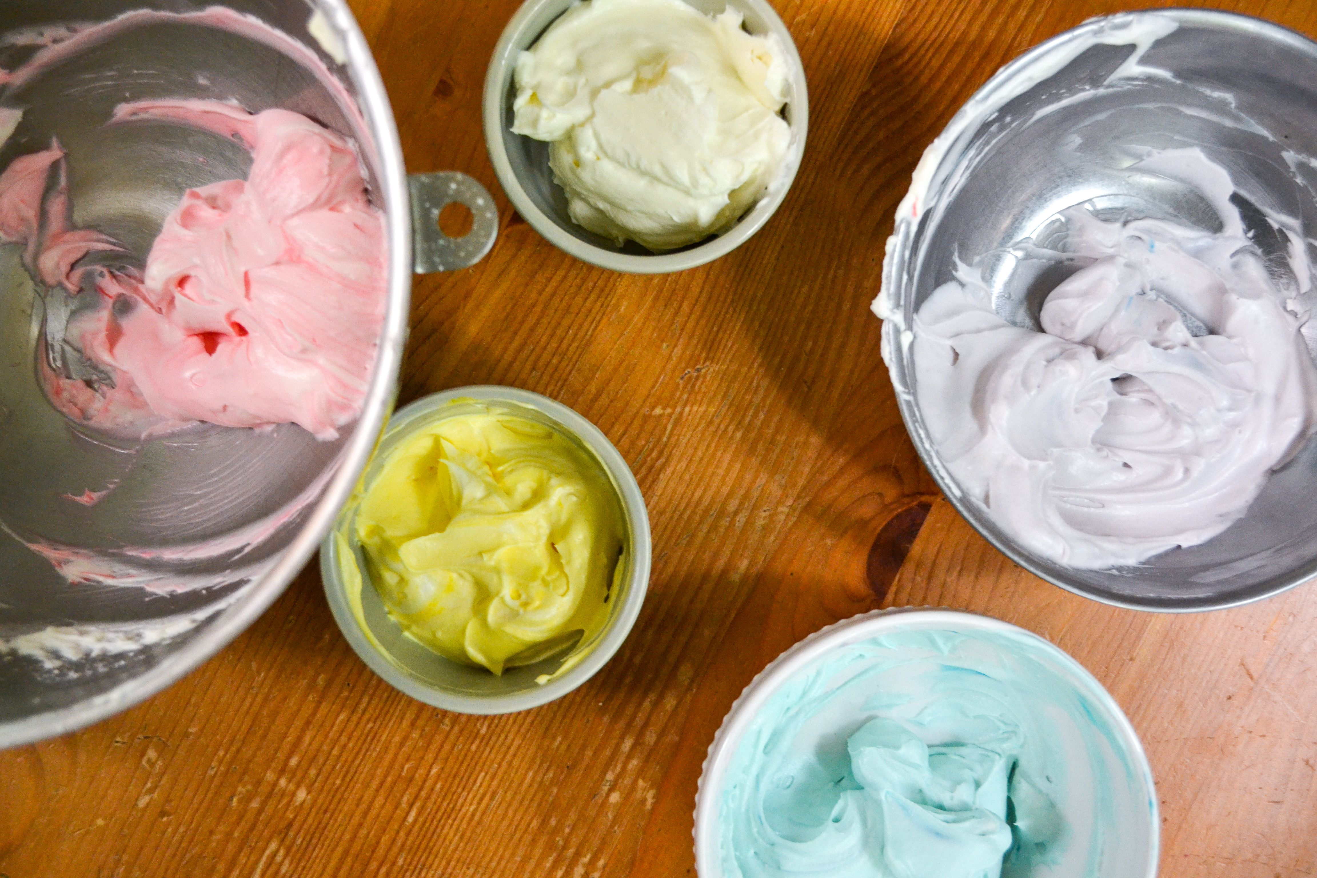 5 bowls with varying pastel colors of fruit dip