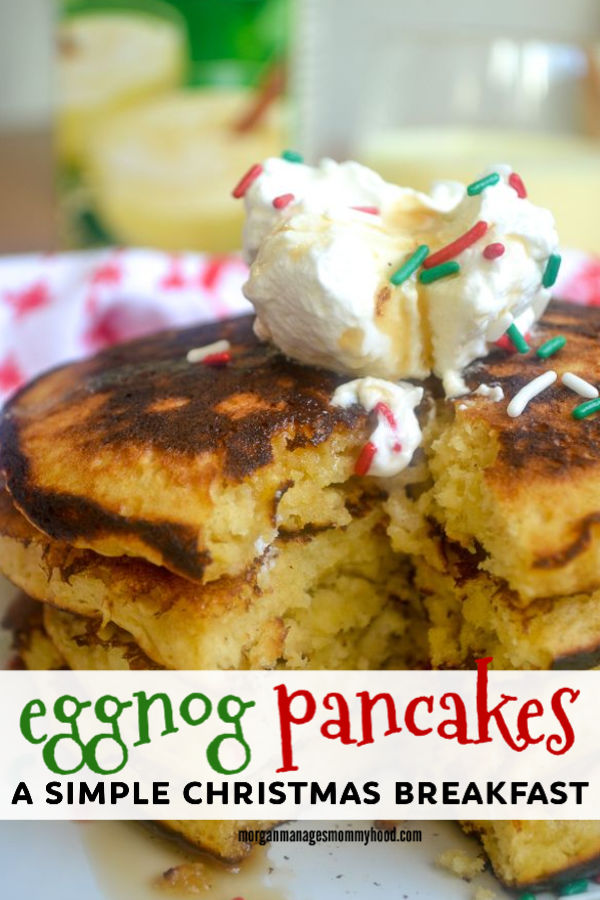pinable image showing a large stack og eggnog pancakes topped with holiday  sprinkles and whipped cream