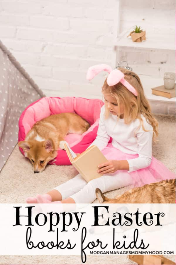 a little girl in white with a pink tutu and bunny ears reading a book with corgis around her