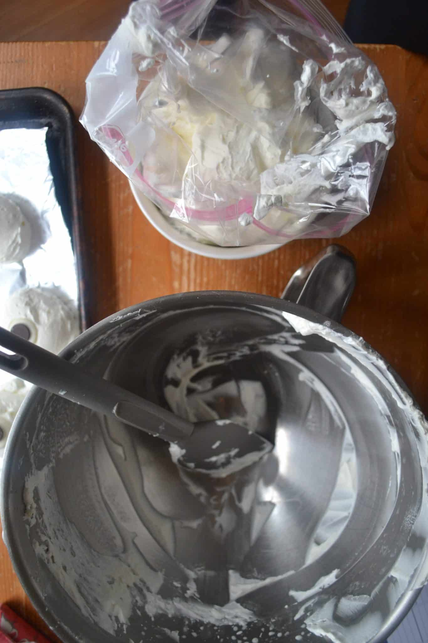a mixing bowl and homemade whipped crema being put into a bag for piping