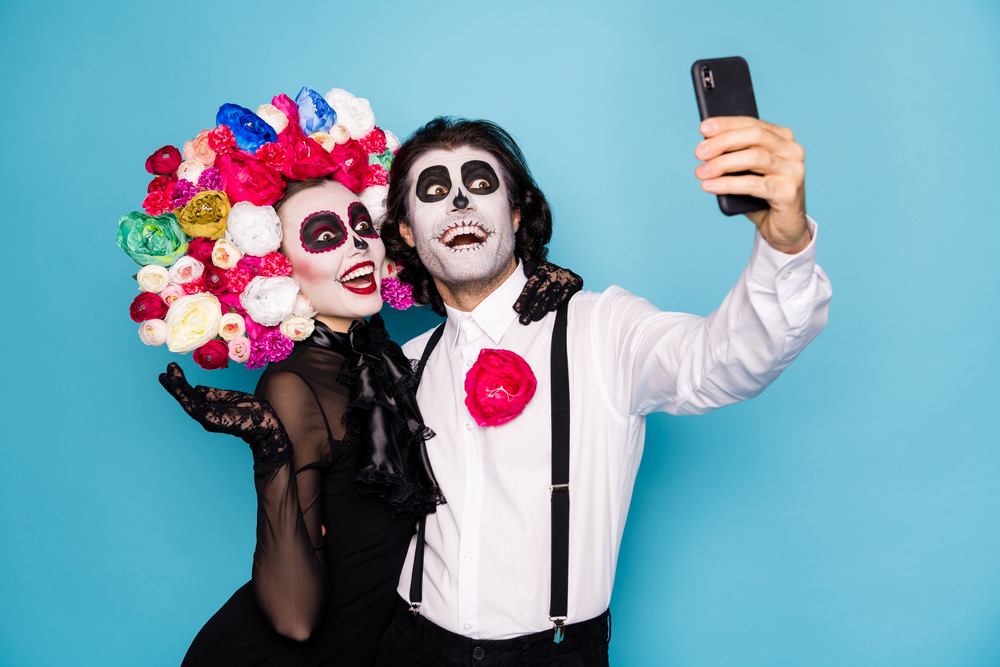virtual halloween party guests in costumes taking a selfie