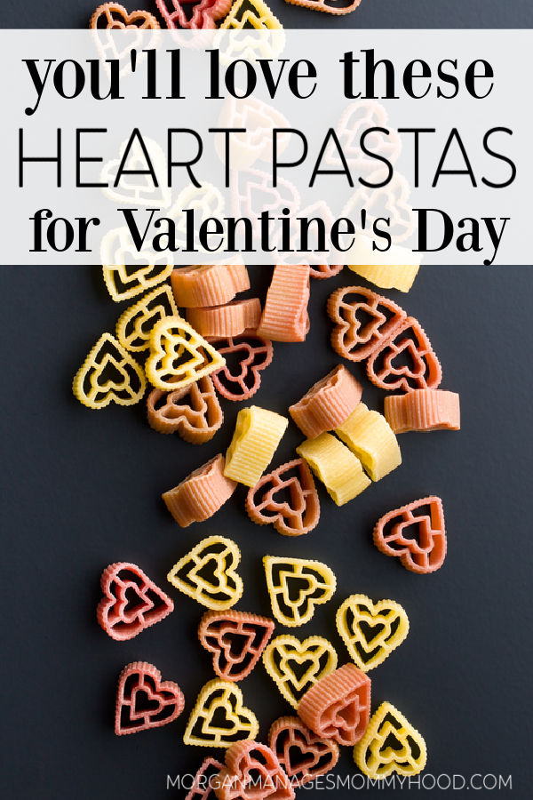 a photo of multicolored heart shaped pastas on a black bacjground