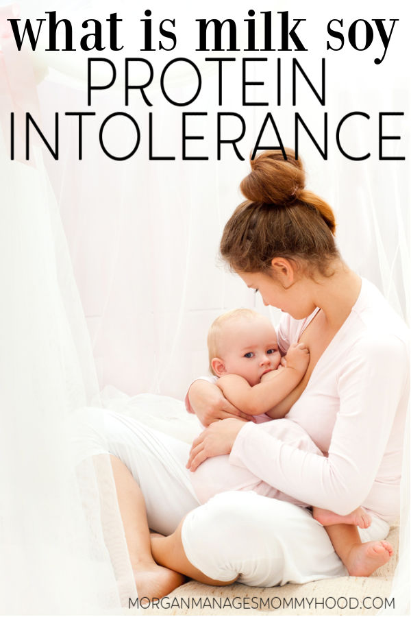 woman breastfeeding a baby in a white room with text overlay reading what is milk soy protein intolerance