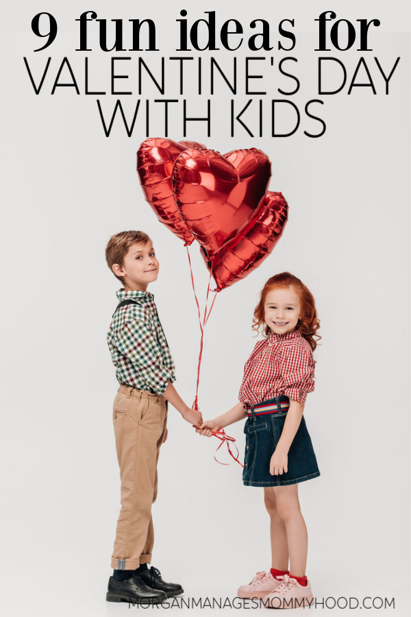two kids standing on a gray backgrounds holding red foil heart balloons with text overlay readin valentines day with kids