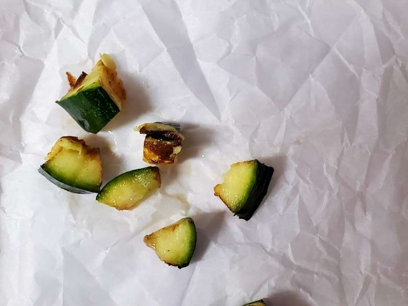 diced roasted zucchini on parchment paper